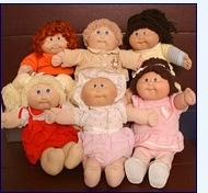 Cabbage patch dolls- my first one was a boy and was like the one in the back in the middle