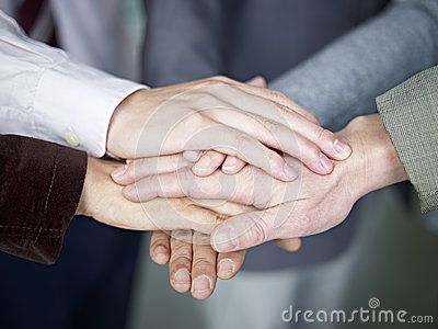 Business team putting hands together by Imtmphoto, via Dreamstime