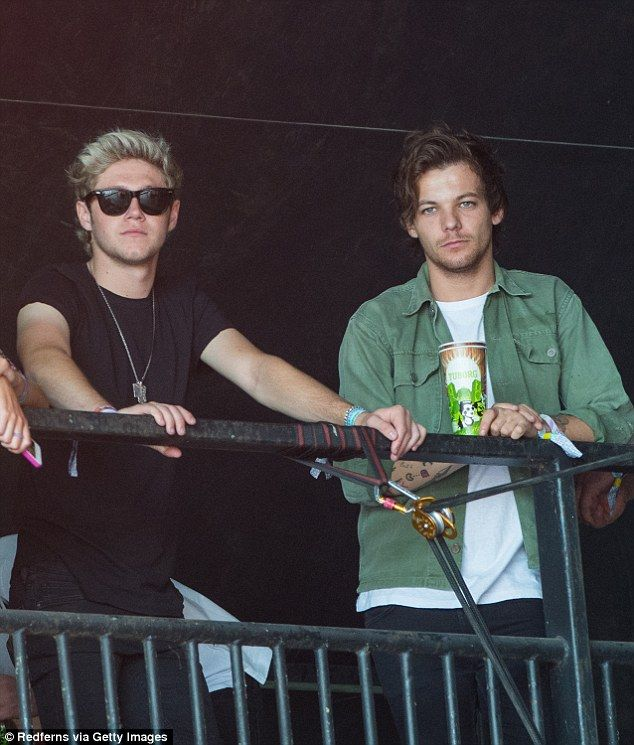 Keeping it casual: Niall was casually dressed in a black T-shirt and jeans while Louis opt...