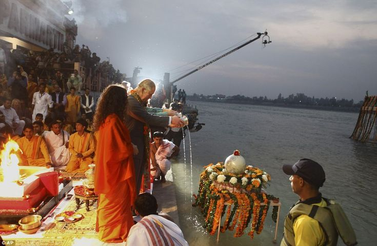 Giving thanks: Britain's Prince Charles and his wife Camilla, Duchess of Cornwall take part in a Hindu ritual at Parmarth Niketan Ashram on the banks of the River Ganges in Rishikesh