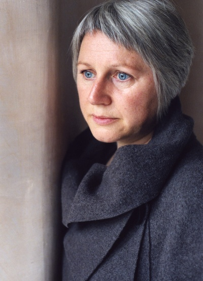Gorgeously grey...hair, sweater...and incredibly blue eyes