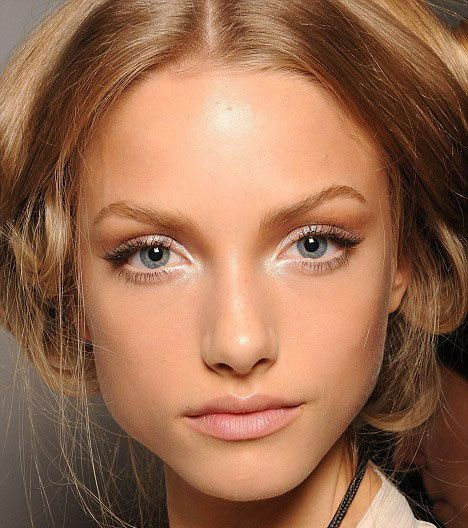 A soft, dewy look for brides. Try white eyeliner and fake eyelashes just on the outer edges to achieve this look.
