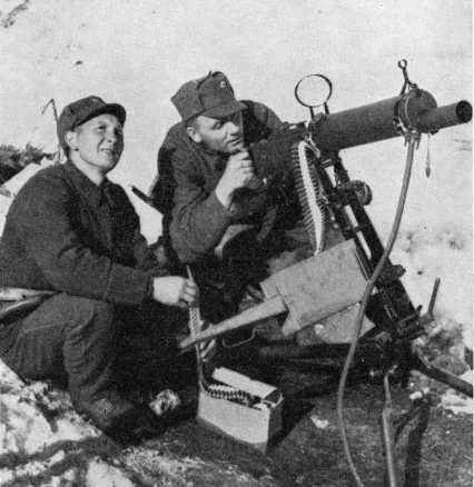 Norwegian Army machine gun crew with Colt M/29 heavy machine gun, near Narvik, Norway, May 1940