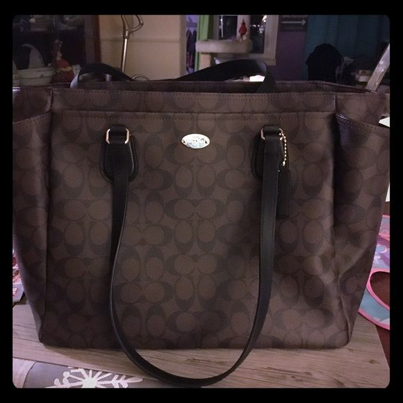 Coach diaper bag Brand new, never used coach diaper bag. Includes strap and changing pad. Coach Bags Baby Bags