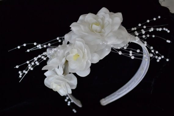 Silver satin hair band covered with white flowers. Decorated with pearl sprays. Very pretty for a wedding flower girl or to attach a veil to the