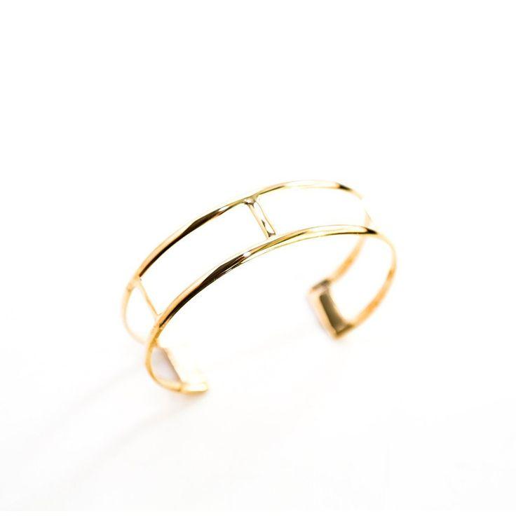 Designer Curve brass cuff bracelets assorted