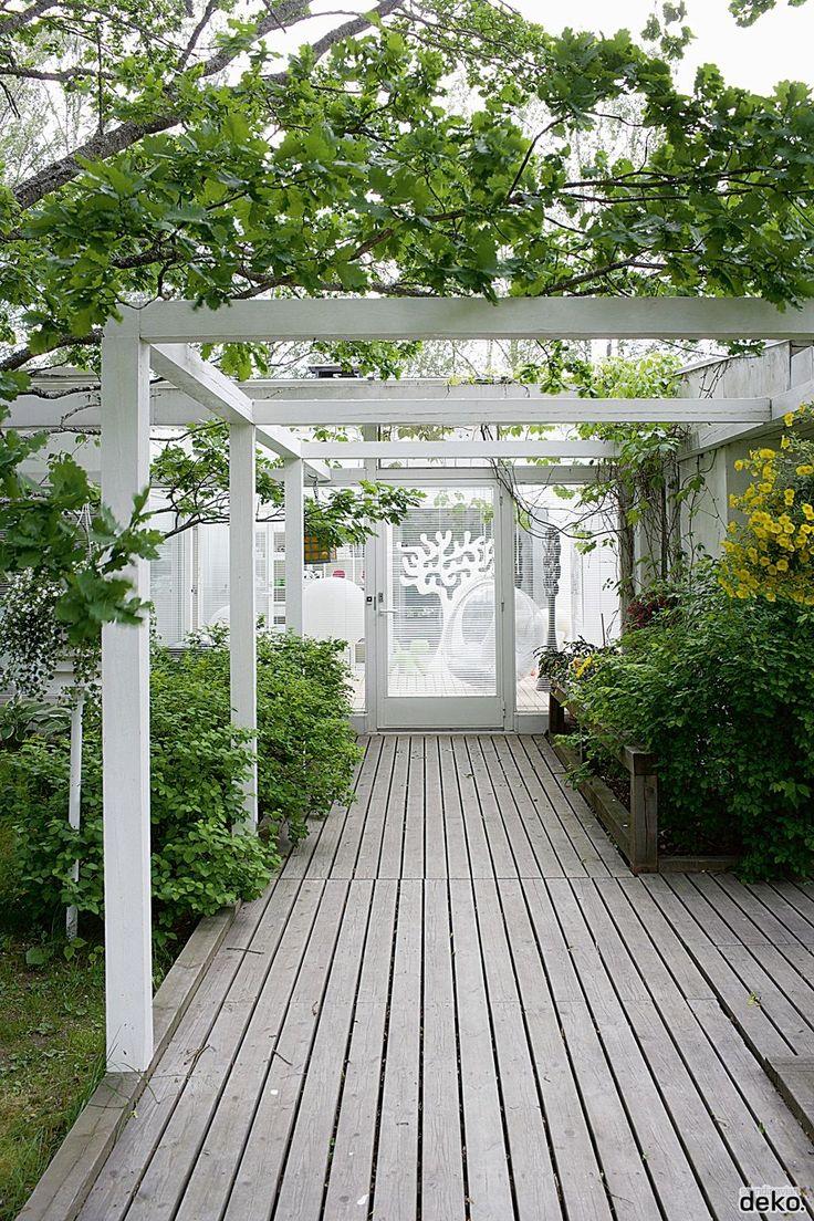 White painted pergola over decking