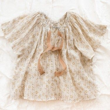 Light and airy with a subtle print. By Louise Louise.
