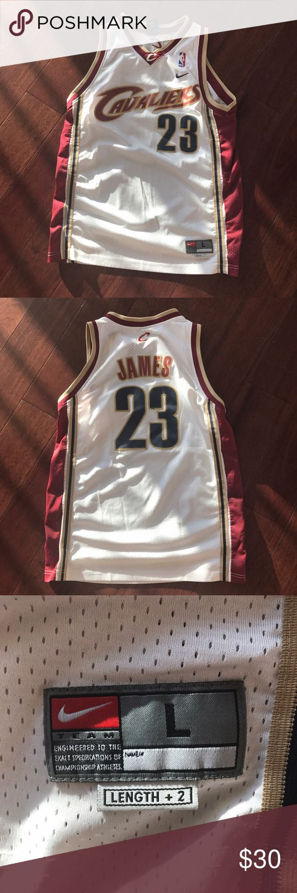 LeBron James OG cavs jersey This is from LeBron's first time on the cavs! Its a OG authentic rare stitched jersey from LeBron's first years in the NBA! Great shape! Youth large or it fit women's small or medium! Go cavaliers show your support for game 4! Nike Tops Muscle Tees