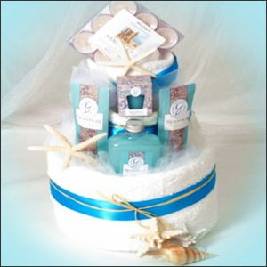 Bridal shower - Cuter beach-themed towel cake gift or centerpiece idea.