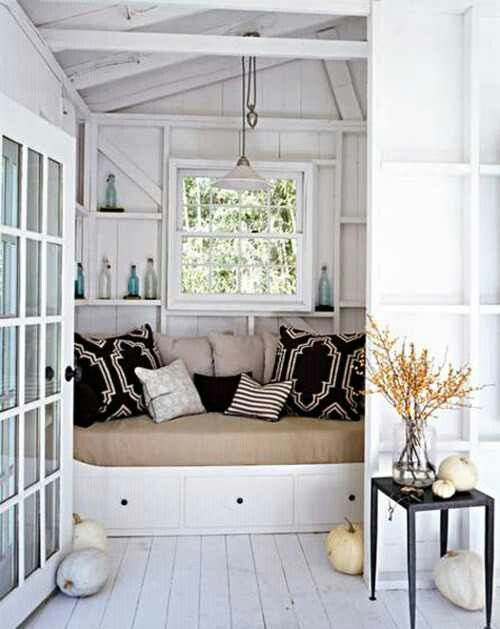 coastal daybed in alcove with white weathered panels