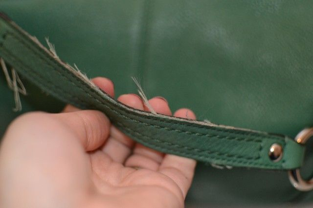 Repairing the edges of a leather bag.