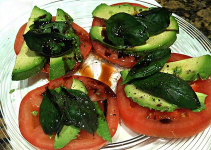 2 large heirloom tomatoes (or any variety if heirloom aren't available)1/2 avocado8 – 16 basil leavesolive oil to tastebalsamic vinegar to tastedash of Himalayan Salt and ground pepper to taste