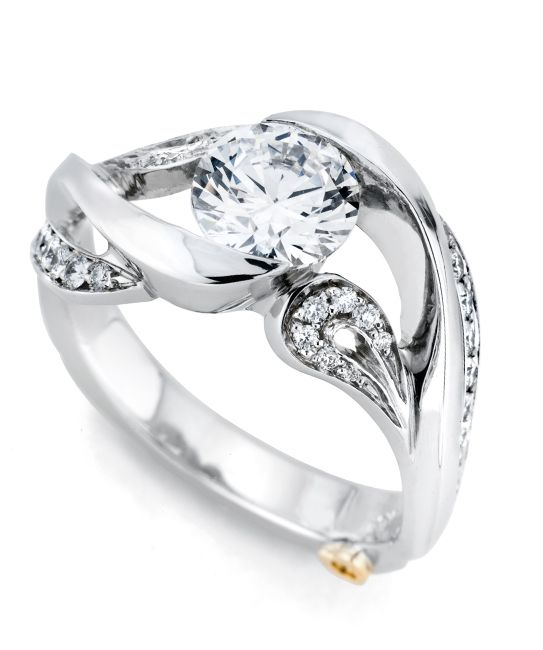 The Honey engagement ring contains 39 diamonds, totaling 0.23ctw. Center stone sold separately, not included in price.The Honey wedding band contains 28 diamonds, totaling 0.14ctw.