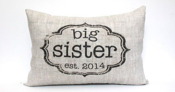 <p>Throw a personalised pillow into the mix to make any big or little sister or brother feel positively proud. $33 from Cover Love.</p>