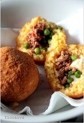 Sicilian Arancini - Rice Balls filled with Meat Sauce, Cheese and Peas, then deep-fried until golden