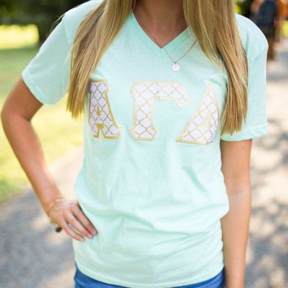 This listing is for ONE Greek letter shirt Shirt details: Next Level Apprel unisex V- neck, Mint Green, S20 Foreground, Metallic gold backing  Please choose your size and organization from the drop down menu   _____________________________________________________________________________________________________   Embroidery: If you would like to add embroidery to your item, please purchase the embroidery listing and follow the directions for that listing. If you purchase multiple shirts and…
