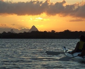Sunset over the Glass House Mountains from Pumicestone Passage