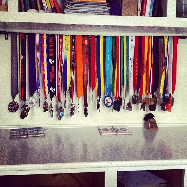 Well duh!  Can't believe I haven't thought of this. Can finally get medals off my clothes hangers and his shelf.