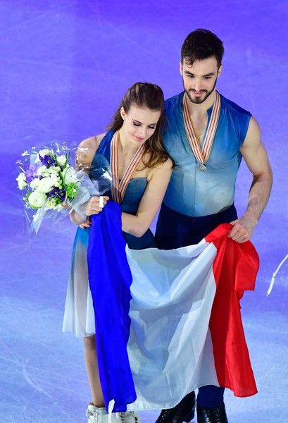 Gabriella Papadakis and Guillaume Cizeron of France pose with their national flag after placing second in the Ice Dance / Free Dance event at the ISU World Figure Skating Championships in Helsinki, Finland on April 1, 2017. / AFP PHOTO / John MACDOUGALL