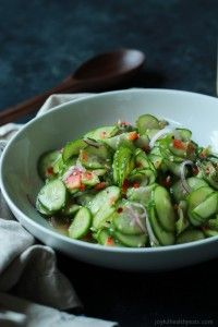 4 c very thinly sliced seedless cucumbers (or mini cucumbers) ¼ c finely sliced red onion ¼ c finely diced red pepper ¼ c rice wine vinegar 1 t sesame seeds ½ t  toasted sesame oil ¼ t red pepper flakes ½ tsea salt