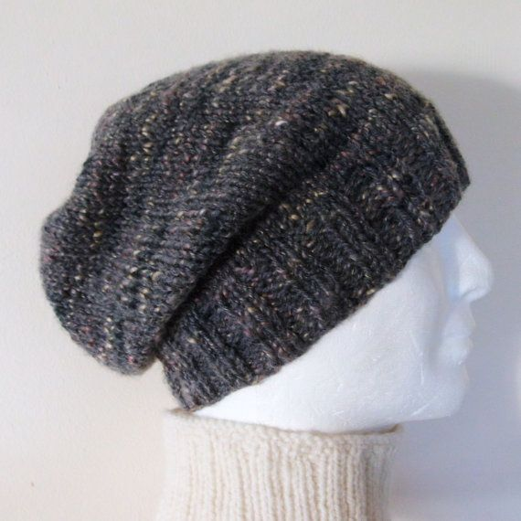 KNITTING PATTERN for MANS SLOUCHY HAT PATTERN Mans Slouchy Hat Knitting Pattern This hat design is a loose, slouchy style which is perfect for both men and women. The beanie style hat has a thick slightly stretchy ribbed brim, and a long , slouchy body. The casual knit hat is cool, comfortable and fashionable . The sample pictured is handknit in a lovely speckled tweed aran wool in shades of gray and black ,speckled with gold The pattern for this hat is both easy and quick, making it perfect…