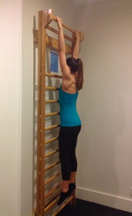 Hang from a stall bar. A popular technique associated with barre workouts is to hang from a stall bar. Natasha Attal, social media manager for Physique 57, says that two minutes of the stall bar can help reduce lower back pain and yield better posture.