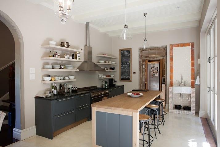 Wynand Wilsenach Architects - House Brudlow Kitchen.  Lanes ceramics klompies look wonderful under the sink