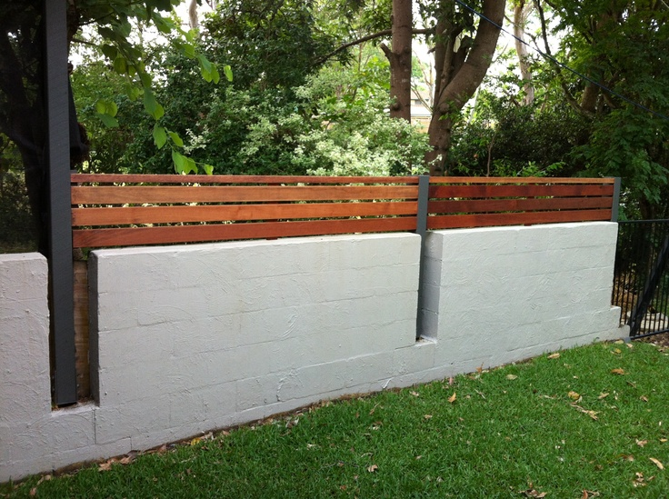 Concrete wall, topped with Merbau screening.