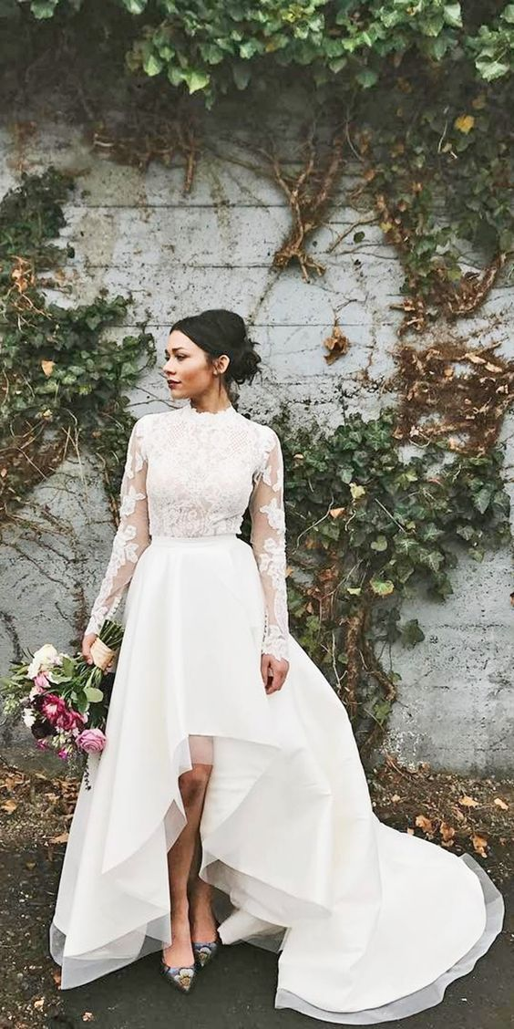 a glam bridal look with a lace applique wedding top with long sleeves and a high... 1