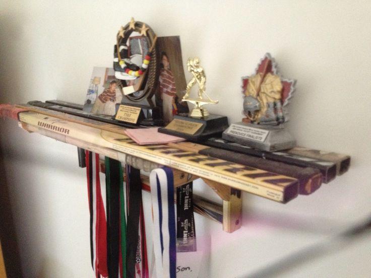 Hockey stick shelf. Made out of recycled hockey sticks.