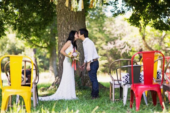 Love the idea of using bright chairs for an outdoor ceremony!