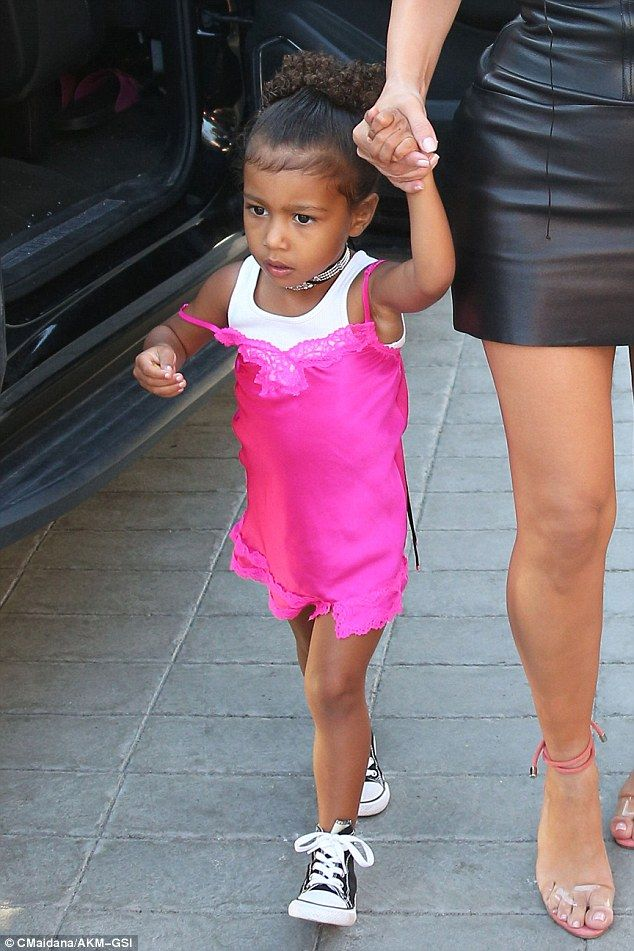 Star of the night:North West looked every bit the princess on Tuesday as she wore a pink dress to her great-grandmother Mary Jo 'MJ' Campbell (Kris Jenner's mother) birthday in San Diego