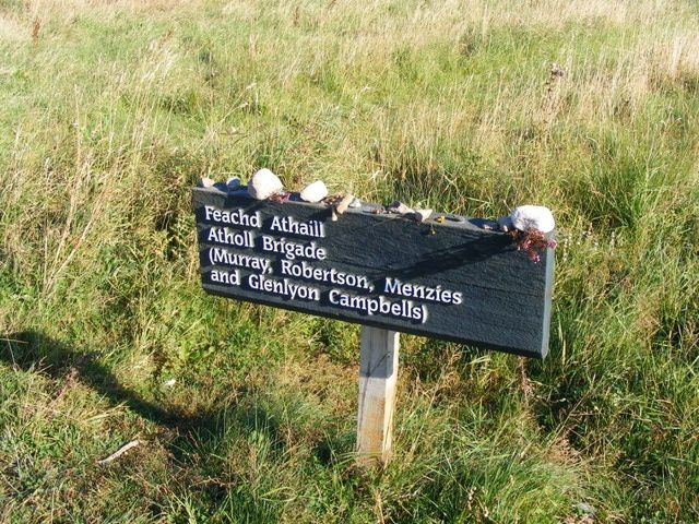 """The Forty-Five: The Battle of Culloden: The Clans Marker for the Atholl Brigade on the extreme right of Jacobite lines. Note the heather and thistle left in memory of the fallen clansmen.  Photograph © 2007 Patricia A. Hickman   While many of Scotland's clans joined the """"Forty-Five"""" many did not. In addition, many of those who fought with the Jacobites did so reluctantly due to their clan obligations."""