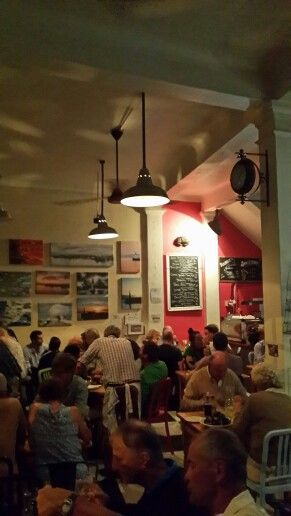 """Olympia Cafe in Kalk Bay - Cape Town. Very popular eatery....and with good reason! Great coffee (uses Truth Coffee beans) and a menu for all taste buds. Always end your meal with one of their sweet choices on display. Their competitively priced mussels is a good choice.The staff are friendly and """"full of personality"""". #OlympiaCafe #KalkBay #CapeTown Address: 134 Main Road Phone: 021 788 6396 Hours: Open daily 7:00 am – 9:00 pm"""