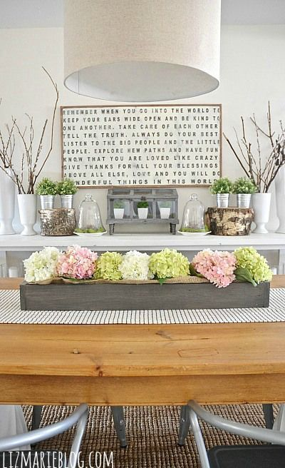 Type, Flowers, natural wood table, grey and pink and mix of gold and silver. My kind of kitchen!