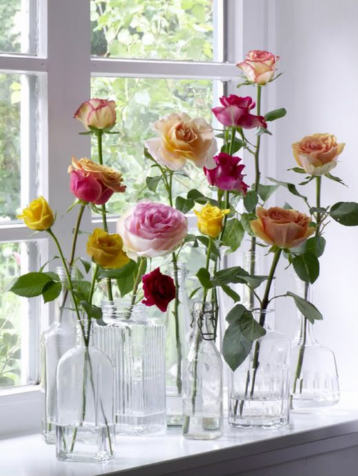 Garden roses in vintage bottles... Fantastic idea for a bouquet of roses that can be spread out instead of all put into a singular vase.