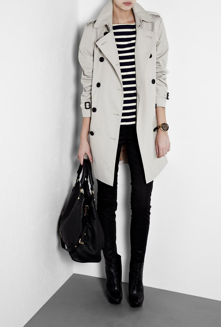 Cotton Trench Coat by Burberry Brit. Model is styled with J Brand Denim Jeans, MICHAEL Michael Kors Boots, Marc by Marc Jacobs Tote and By Malene Birger Top.