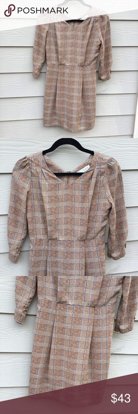 "Retro brown dress 3/4 sleeve V-neck Size S ⭐️ Retro style, Brown plaid pattern, Mini dress ⭐️ Zipper on the back  ⭐️ V-Neck, 3/4 Sleeve  ⭐️ Size S, Measurements laying flat:      Length 33"", Bust 18"", waist 14"", sleeve length 18"", shoulder width 15"" Dresses Mini"