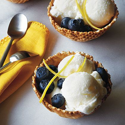 Dress up scoops of tangy buttermilk ice cream with in-season berries, sliced stone fruit, or lemon rind strips. Waffle bowls make a fun...