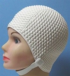 Those bubble swimming caps with a strap under the chin....I HATED it