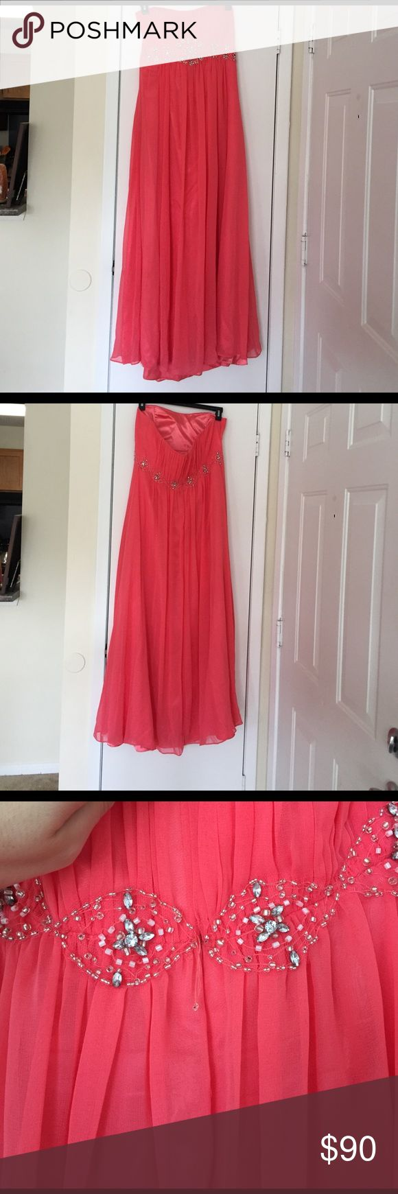 Coral Prom/Formal Dress Fiesta Coral Prom Dress. Only worn once! Last two pictures show the only signs of wear which is a small tear by the zipper and a few beads are loose by the zipper- both not noticeable unless you know they are there. I also have the matching Shaw! Strapless! fiesta Dresses Prom