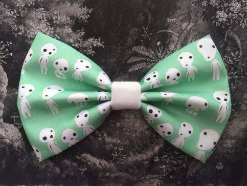This bow is made out of Kodama inspired fabric designed and handmade by me. You can pick hair bow style with an attached barrette, or alligator clip. Bow tie style is also available with an attached bar pin.(examples in last picture)  Bow measures about 11 cm wide and 7 cm high.  Please remem...