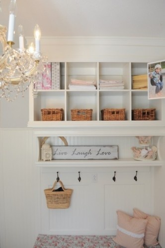 Looks like a wall mounted Expedit bookcase from Ikea with molding and trim  added to make