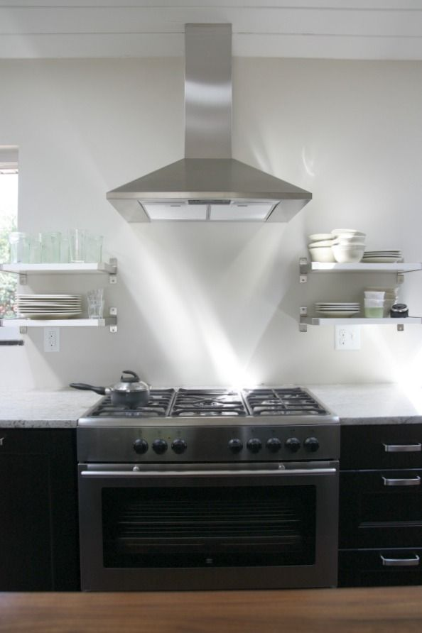 Shelf Next To Chimney Hood ~ Open shelving in the kitchen makes grabbing a glass of