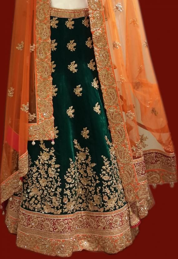 Bridal Lehengas - Velvet Dark Green Lehenga with Gold Zardosi Border and orange border, Orange net dupatta with gold embroidery by Frontier Bazar | WedMeGood #wedmegood #velvet #lehengas