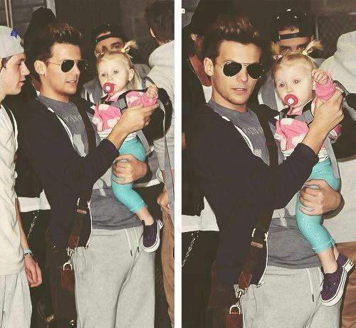 Louis Tomlinson and baby lux. In the first pic u can c a little bit of niall horan