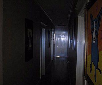 Dark hallway with one lit room