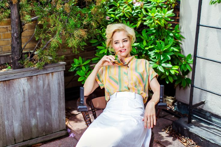 Parker Posey on the roof deck of her apartment building in Manhattan. (Photo: Bryan Derballa for The New York Times)