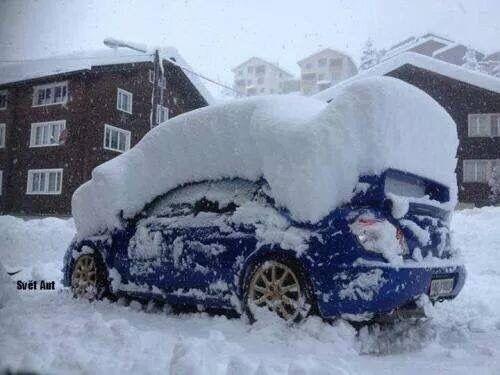 Subaru Impreza WRX STi buried in the snow
